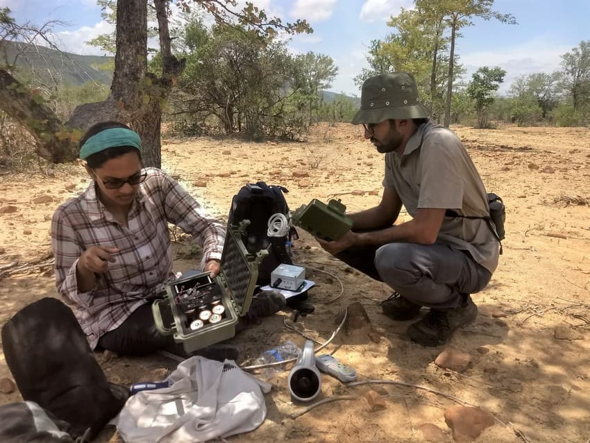 Chiti Arvind (left) along with a team member engaged in field deployment of recorders.